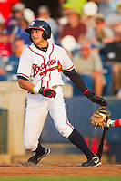Ramon Flores #8 of the Rome Braves follows through on his swing against the Greenville Drive at State Mutual Stadium July 24, 2010, in Rome, Georgia.  Photo by Brian Westerholt / Four Seam Images