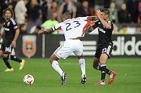 Washington, D.C.- March 29, 2014. Jose Goncalves (23) of the New England Revolution goes against Perry Kitchen (23) of D.C. United.  D.C. United defeated the New England Revolution 2-0 during a Major League Soccer Match for the 2014 season at RFK Stadium.