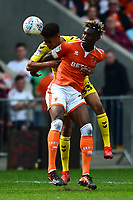 Blackpool's Armand Gnanduillet competes with Fleetwood Town's James Hill<br /> <br /> Photographer Richard Martin-Roberts/CameraSport<br /> <br /> The EFL Sky Bet League One - Blackpool v Fleetwood Town - Monday 22nd April 2019 - Bloomfield Road - Blackpool<br /> <br /> World Copyright © 2019 CameraSport. All rights reserved. 43 Linden Ave. Countesthorpe. Leicester. England. LE8 5PG - Tel: +44 (0) 116 277 4147 - admin@camerasport.com - www.camerasport.com