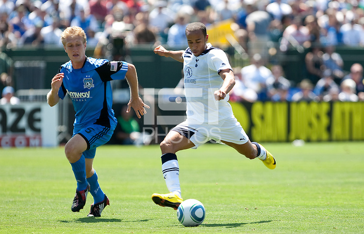 Andros Townsend (right) kicks the ball ahead of Brad Ring (left). San Jose Earthquakes tied  Tottenham Hotspur 0-0 at Buck Shaw Stadium in Santa Clara, California on July 17th, 2010.