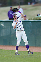 High Point Panthers first baseman Spencer Angelis (11) catches a foul pop fly during the game against the Coastal Carolina Chanticleers at Willard Stadium on March 15, 2014 in High Point, North Carolina.  The Panthers defeated the Chanticleers 11-8 in game two of a double-header.  (Brian Westerholt/Four Seam Images)