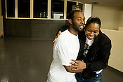 Erick Daniels and his sister, Erika, embrace one another as he leaves the Durham County Jail a free man on Friday, Sept. 19, 2008. .