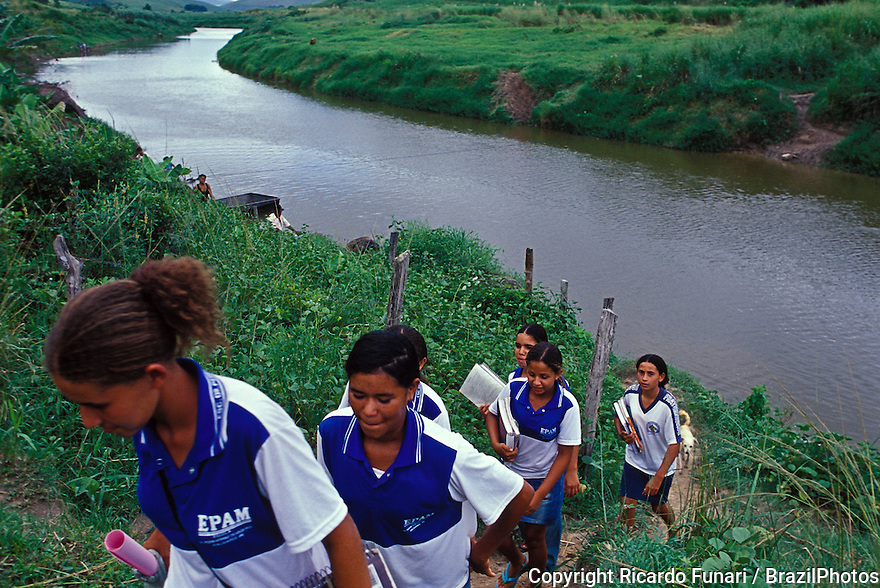 Education, students go to rural school early in the morning by crossing a river near Palmares city rural area in Pernambuco State, Brazil.