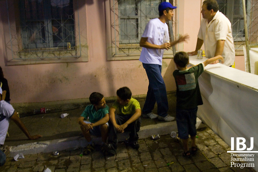 Photo taken in Itapecerica, a town in close proximity to Divinopolis, Brazil. Familes are pictured here enjoying local drink and listening to music. Itapecerica celebrated its annual Winter Festival with capoeira tournaments, music, street food and carnival attractions. 2008 JusticeMaker Dr. Aziz Saliba is creating two educational DVDs in Divinopolis about citizen rights to habeas corpus and the Inter-American Court.