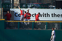 Indianapolis Indians pitcher John Holdzkom (52) catches a two run home run hit by teammate Keon Broxton (not pictured) as outfielder Eric Farris (5) looks on during a game against the Rochester Red Wings on June 10, 2015 at Frontier Field in Rochester, New York.  Indianapolis defeated Rochester 5-3.  (Mike Janes/Four Seam Images)