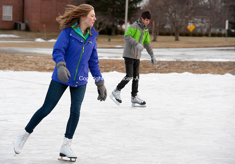 GOSHEN, CT-010114JS02- Allie Meeker, 17,  of Warren and Kyle Farrell, 17, of Goshen enjoy New Years Day by ice skating on the Goshen Parks and Recreation department's ice skating rink at Goshen Center School in Goshen on Wednesday.<br /> Jim Shannon Republican-American