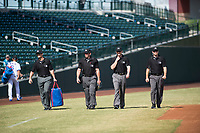 The umpire crew made up of Adam Beck, Bryan Fields, Blake Carnahan and Brian Peterson walk onto the field before an Arizona Fall League game between the Peoria Javelinas and Mesa Solar Sox at Sloan Park on October 24, 2018 in Mesa, Arizona. Mesa defeated Peoria 4-3. (Zachary Lucy/Four Seam Images)