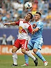 Connor Lade #5 of New York Red Bulls, left, and Jack Harrison #11 of NYC Football Club battle for possession during a Major League Soccer match at Yankee Stadium on Sunday, July 3, 2016. NYCFC won by a score of 2-0.
