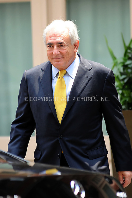 WWW.ACEPIXS.COM . . . . . .July 6, 2011...New York City...Dominique Strauss Kahn leaves his home on July 6, 2011 in New York City....Please byline: KRISTIN CALLAHAN - ACEPIXS.COM.. . . . . . ..Ace Pictures, Inc: ..tel: (212) 243 8787 or (646) 769 0430..e-mail: info@acepixs.com..web: http://www.acepixs.com .
