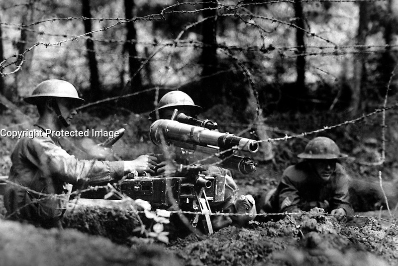 French &quot;37&quot; in firing position on parapet in second-line trench.  This gun has a maximum range of a mile and a half, is more accurate than a rifle, and is capable of firing 28 rounds a minute.  Dieffmatten, Germany.  June 26, 1918.   Cpl. Allen H. Hanson. (Army)<br /> NARA FILE #:  111-SC-19753<br /> WAR &amp; CONFLICT BOOK #:  621