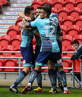 Matthew Bloomfield of Wycombe Wanderers celebrates with team mates after he scores the opening goal of the game during the Sky Bet League 2 match between Doncaster Rovers and Wycombe Wanderers at the Keepmoat Stadium, Doncaster, England on 29 October 2016. Photo by David Horn.
