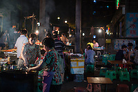 Shaokao barbecue stands operate outside the B District Middle Gate of Chongqing University in the Shapingba district of Chongqing, China.