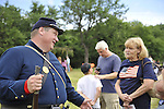 Old Bethpage, New York, USA - July 21, 2012: At left, ROBERT WALKER of Coram, NY, Federal Re-enactor, talks with visitor at re-creation of life in Camp Scott, a Union Army training camp, at Old Bethpage Village Restoration, to commemorate 150th Anniversary of American Civil War, on Saturday, July 21, 2012.