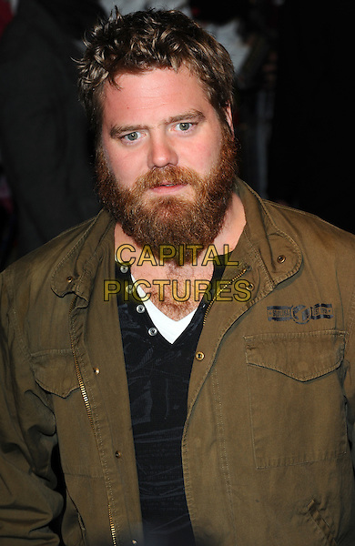 RYAN DUNN.The UK premiere of 'Jackass 3D' at BFI IMAX, London, England, UK..November 2nd, 2010.half length black top green jacket beard facial hair .CAP/CJ.©Chris Joseph/Capital Pictures.