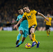 11th February 2019, Molineux, Wolverhampton, England; EPL Premier League football, Wolverhampton Wanderers versus Newcastle United; Diogo Jota of Wolverhampton Wanderers on the ball being tackled by Deandre Yedlin of Newcastle United