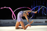 Liubov Charkashyna of Belarus performs with ribbon during event finals at World Cup Montreal on January 30, 2011.  (Photo by Tom Theobald).