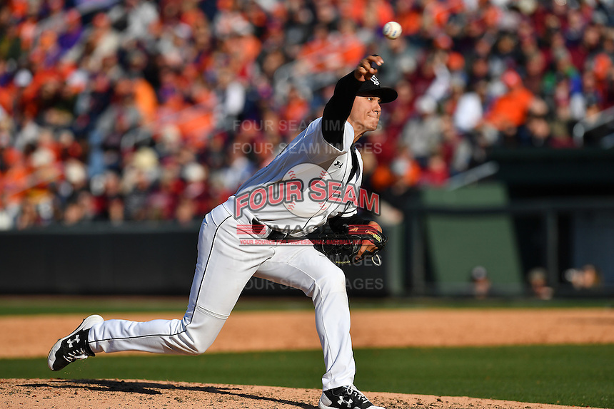 Pitcher Tyler Johnson (21) of the South Carolina Gamecocks delivers in the Reedy River Rivalry game against the Clemson Tigers on Saturday, March 4, 2017, at Fluor Field at the West End in Greenville, South Carolina. Clemson won, 8-7. (Tom Priddy/Four Seam Images)
