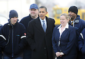Chicago, IL - January 4, 2009 -- United States President-elect Barack Obama (C) poses with flight support employees before boarding his plane and departing for Washington, DC USA in Chicago, Illinois, USA 04 January 2009. Obama will join his wife and children who are already in Washington as he prepares to take office on 20 January 2009. .Credit: Tannen Maury - Pool via CNP