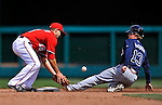 2 April 2011: Atlanta Braves outfielder Nate McLouth is safe at second as infielder Danny Espinosa is unable to hold onto the ball during a game against the Washington Nationals at Nationals Park in Washington, District of Columbia. The Nationals defeated the Braves 6-3 in the second game of their season opening series. Mandatory Credit: Ed Wolfstein Photo