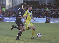 Stephen Mallan gets the better of Steven Saunders in the Ross County v St Mirren Scottish Professional Football League match played at the Global Energy Stadium, Dingwall on 17.1.15.