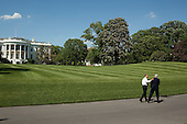 United States President Barack Obama walks along the South Lawn Drive of the White House, with U.S. Senator John Kerry (Democrat of Massachusetts), Wednesday, May 5, 2010.  .Mandatory Credit: Pete Souza - White House via CNP