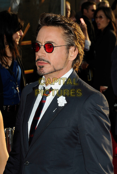 "ROBERT DOWNEY JR. .arriving at Paramount Pictures and Marvel Entertainment's world premiere of ""Iron Man 2"" at El Capitan Theatre in Hollywood, California, USA, .April 26th, 2010..portrait headshot red tinted sunglasses glasses black suit tie beard facial hair side profile navy blue flower shirt white .CAP/ROT.©Lee Roth/Capital Pictures"