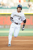 Gorkys Hernandez (9) of the Charlotte Knights hustles towards third base against the Durham Bulls at BB&T Ballpark on April 24, 2014 in Charlotte, North Carolina.  The Knights defeated the Bulls 4-3.  (Brian Westerholt/Four Seam Images)