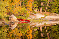 &quot;Fall Landing&quot;<br /> Our canoes await their next outing on our Fall wilderness trip in the Boundary Waters Canoe Area Wilderness (BWCAW). As we explored our newly discovered campsite, I caught sight of our cherry red canoes along the autumn-kissed shoreline. The scene perfectly reflected the wilderness experience in autumn. <br /> <br /> This photograph is from our Canoescapes Series. It was also recognized as one of 10 finalists in the Sustainable Travel category of the 13th Annual Smithsonian Photo Contest. There were 46,000 entries from 168 countries.
