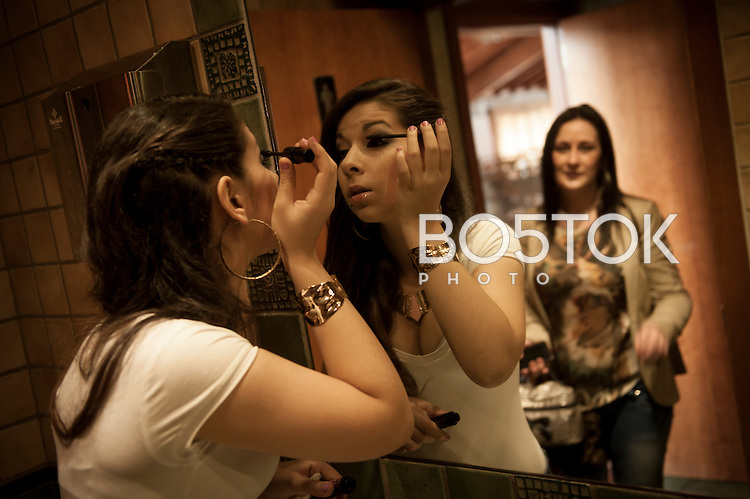 Laura Gabarri, who was participating at Miss Gitana Euskadi 2014 beauty contest, paints her eyes as her mother wacthes. Urnieta (Basque Country) April 8, 2014.2nd. Miss Gitana is an annual pageant that is run by association Miss Gitana, an association of Gypsy women which is dedicated to creating events for the Roma women. After being choosed several girls from diferent territories, a bigger contest is celebrated to select the Miss Gitana of Spanish State.(Gari Garaialde / Bostok Photo)
