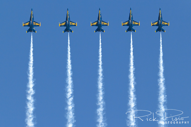 Blue Angels in a line abreast formation during a loop maneuver.