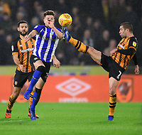 Sheffield Wednesday's Sam Hutchinson vies for possession with Hull City's Evandro Goebel<br /> <br /> Photographer Chris Vaughan/CameraSport<br /> <br /> The EFL Sky Bet Championship - Hull City v Sheffield Wednesday - Saturday 12th January 2019 - KCOM Stadium - Hull<br /> <br /> World Copyright © 2019 CameraSport. All rights reserved. 43 Linden Ave. Countesthorpe. Leicester. England. LE8 5PG - Tel: +44 (0) 116 277 4147 - admin@camerasport.com - www.camerasport.com