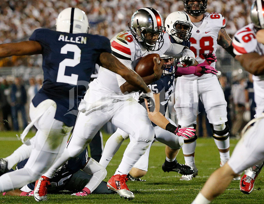 Ohio State Buckeyes quarterback J.T. Barrett (16) cuts through the Penn State defense in the second  quarter of their game at Beaver Stadium in State College, PA on October 25, 2014. (Columbus Dispatch photo by Brooke LaValley)