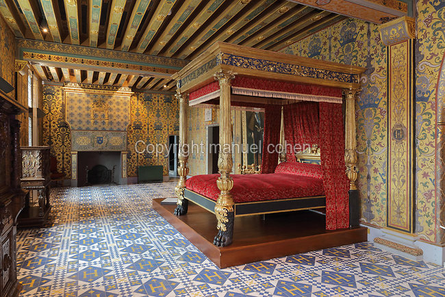 Chambre du Roi, or King's Bedroom, on the second floor of the Francois I wing, built early 16th century in Italian Renaissance style, at the Chateau Royal de Blois, built 13th - 17th century in Blois in the Loire Valley, Loir-et-Cher, Centre, France. The room is decorated in the style of Henri III, and was used by the close circle of the King, for audiences, meetings and entertainment, as well as as a bedroom. The room has hand-painted wallpaper, a 4-poster bed, tiled floor and painted ceiling, and was restored by Felix Duban in 1861-66. The chateau has 564 rooms and 75 staircases and is listed as a historic monument and UNESCO World Heritage Site. Picture by Manuel Cohen