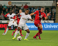 Pictured L-R: Wayne Routledge of Swansea against Dave Winfield of York  Tuesday 25 August 2015<br /> Re: Capital One Cup, Round Two, Swansea City v York City at the Liberty Stadium, Swansea, UK.