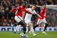 Paul Pogba of Manchester United competes with Andy King of Swansea City during the Premier League match between Manchester United and Swansea City at the Old Trafford, Manchester, England, UK. Saturday 31 March 2018