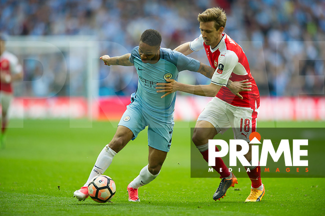Manchester City Raheem Sterling and Arsenal's Nacho Monreal during the FA Cup Semi Final match between Manchester City and Arsenal at the Wembley  Stadium, Manchester, England on 23 April 2017. Photo by Andrew Aleksiejczuk / PRiME Media Images.