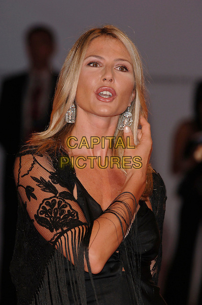 "NATALIE CALDONAZZO.62nd International Film Festival,.At the premiere of ""Good Night, And Good Luck"".Venice, 1st September 2005.portrait headshot La Bienale black gown dress lace shawl silver earrings hand.Ref: PL.www.capitalpictures.com.sales@capitalpictures.com.©Capital Pictures."