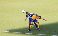Aaron Pierre of Wycombe Wanderers & Matt Green of Mansfield Town battle for the ball during the Sky Bet League 2 match between Wycombe Wanderers and Mansfield Town at Adams Park, High Wycombe, England on 25 March 2016. Photo by Andy Rowland.
