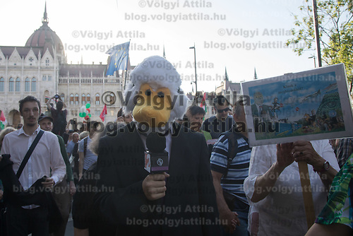 Man dressed as a duck makes joke of the fake news of the state media as he participates in a demonstration against the outcome of the general elections in Budapest, Hungary on April 21, 2018. ATTILA VOLGYI