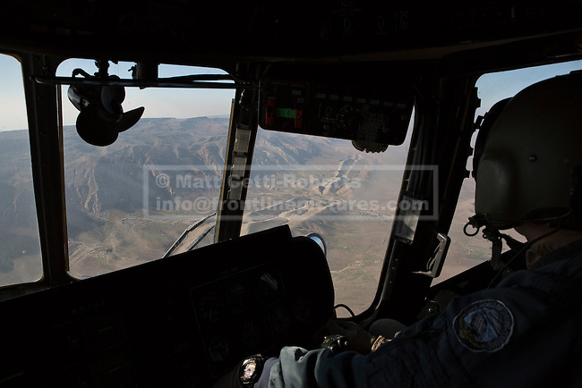 11/12/2014. Sinjar Mountains, Iraq. Mount Sinjar is seen through the cockpit windows of an Iraqi Air Force Mi-171E Hip helicopter during a mission to supply Yazidi refugees on the 75 mile long ridge-line. <br /> <br /> Although a well publicised exodus of Yazidi refugees took place from Mount Sinjar in August 2014 many still remain on top of the 75 km long ridge-line, with estimates varying from 2000-8000 people, after a corridor kept open by Syrian-Kurdish YPG fighters collapsed during an Islamic State offensive. The mountain is now surrounded on all sides with winter closing in, the only chance of escape or supply being by Iraqi Air Force helicopters.
