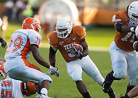 30 September 2006: Texas back Chris Ogbonnaya (#3) dodges Sam Houston State defender Chadd Oliphant (#29) during the Longhorns 56-3 victory over the Sam Houston State Bearkats at Darrell K Royal Memorial Stadium in Austin, TX.