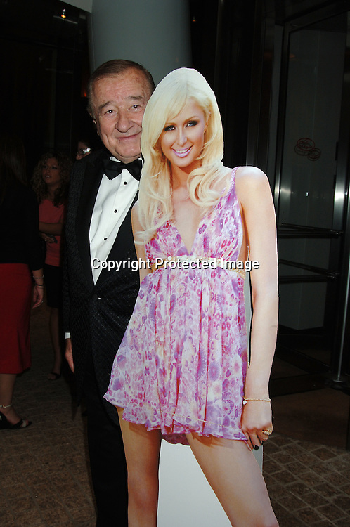 Sirio Maccioni, owner of Le Cirque with Paris Hilton Cut out..arriving at the party thrown by Kathy and Rick Hilton for ..their daughter Paris Hilton for her new perfume on June 14, 2006 at Le Cirque. ..Robin Platzer, Twin Images..