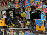 A shopkeeper at the counter at the variety store in Madras, India