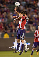Chivas USA midfielder Ben Zemanski (21) battles San Jose Earthquakes midfielder Joey Gjertsen (17). CD Chivas USA defeated the San Jose Earthquakes 3-2 at Home Depot Center stadium in Carson, California on Saturday April 24, 2010.  .