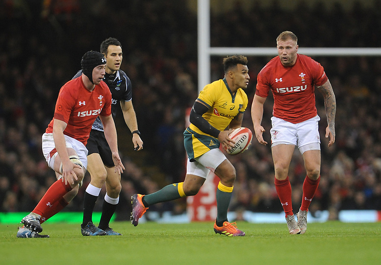 Australia's Will Genia looks to offload <br /> <br /> Photographer Ian Cook/CameraSport<br /> <br /> Under Armour Series Autumn Internationals - Wales v Australia - Saturday 10th November 2018 - Principality Stadium - Cardiff<br /> <br /> World Copyright © 2018 CameraSport. All rights reserved. 43 Linden Ave. Countesthorpe. Leicester. England. LE8 5PG - Tel: +44 (0) 116 277 4147 - admin@camerasport.com - www.camerasport.com