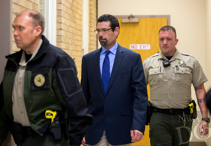 NWA Democrat-Gazette/JASON IVESTER<br /> Benton County Sheriff's Office deputies accompany Brian Post (center), 48, of Springdale, as he is led Friday, Feb. 24, 2017 at the Benton County Courthouse in Bentonville. Post is charged with attempted capital murder, five counts of rape and first-degree battery.
