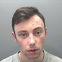 COPY BY TOM BEDFORD<br /> Pictured: Police custody picture of Keiran Wathan<br /> Re: Burglar Keiran Wathan has been jailed for 18 years by Swansea, Crown Court, for killing a woman and injuring her husband after they tried to stop him fleeing their home.<br /> 24 year old Wathan, of Ystalyfera, south Wales, used a kinife to attack Sheila and Wayne Morgan after breaking into their home in the Morriston area of Swansea, Wales.<br /> Mrs Morgan, 71, later died from sepsis after her wounds became infected.<br /> Wathan admitted manslaughter, wounding with intent and possessing a bladed article, at Swansea Crown Court.