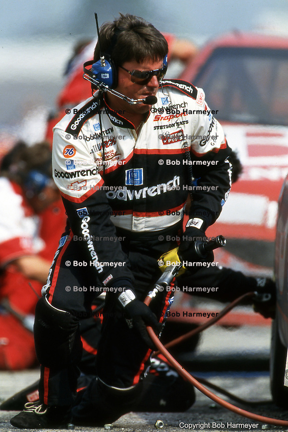 Andy Petree at work on Dale Earnhardt's car during a pit stop in a 1994 NASCAR race at Darlington Raceway near Darlington, North Carolina.