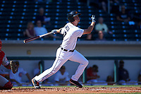 Mesa Solar Sox shortstop AJ Simcox (17), of the Detroit Tigers organization, follows through on his swing during an Arizona Fall League game against the Glendale Desert Dogs on October 28, 2017 at Sloan Park in Mesa, Arizona. The Solar Sox defeated the Desert Dogs 9-6. (Zachary Lucy/Four Seam Images)