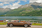 Classic car parked by Lake Sils in the Graubunden region headed towards St. Mortiz, Switzerland during the British Class Car Meeting, an annual event featuring: Rolls-Royce, Bentley, Aston Martin & Lagonda, Jaguar & Daimler, and Austin-Healey & Healey and a limited number of pre-1960 British cars